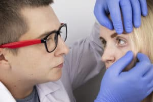 An ophthalmologist examines a woman who complains of a burning sensation and pain in her eyes. Eye fatigue from a computer screen or telephone (sand sensation on the cornea). The concept of early diagnosis of glaucoma